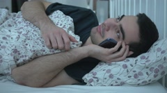 4K Talking Smartphone Cell In Bed Nightime Stock Footage