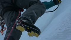 Alpine climbing boots ice breaking - stock footage