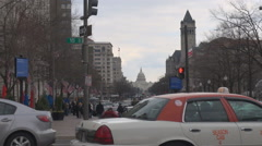 Heavy traffic street pedestrian people travel Capitol dome Washington DC cloudy  Stock Footage