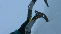 Ice climbing detail ice axes Stock Footage