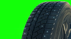Car studded winter tyre wheel rotate on camera in motion - stock footage