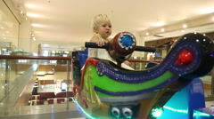 little blonde child sit in toy boat - stock footage