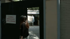 2 Shots: Entrance to illegal CD DVD shop in China. Stock Footage