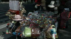 2 Shots: Street side vendor selling various sundry goods. Stock Footage
