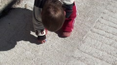 Baby draws with a chalk on pavement Stock Footage