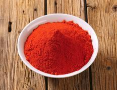 Paprika powder in a bowl Stock Photos
