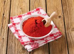 Paprika powder in a bowl - stock photo