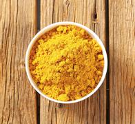 Heap of curry powder in a bowl Stock Photos