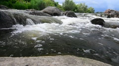 Small waterfall on beautiful river - moving and bustling water flow Stock Footage