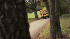 School Bus Drives Down Wooded Path Arkistovideo