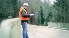 Engineer with documentation on the bridge - stock footage