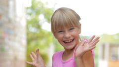 Happy Kid Girl Jumping Turned And Joyful Smiling Outdoors HD Stock Footage