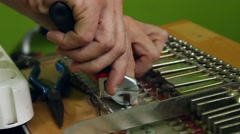 Hands fixing a piano with tools Stock Footage