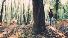 Teenager girl with binoculars in the forest. Handheld shot - stock footage