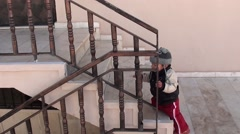 Baby goes upstairs and knocks a closed door Stock Footage