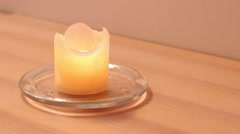 Relaxing candle on a wooden surface Stock Footage