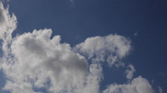 Moving clouds and blue sky time lapse Stock Footage