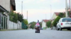Odd dwarf statue miniature in the middle of the street Stock Footage
