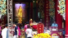 Chinese Buddhist temple with people praying, Bangkok Stock Footage