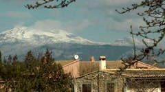 Spain Mallorca Island various 004 snow covered mountains behind country house Stock Footage