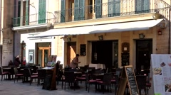 Stock Video Footage of Spain Mallorca Island Alcudia 020 street cafe with outside seats under awning