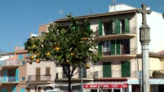 Spain Mallorca Island Alcudia 013 Spanish house behind orange tree Stock Footage