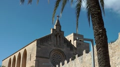Spain Mallorca Island Alcudia 009 church nave and old city wall Stock Footage