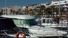 Spain Mallorca Island Port d'Alcudia 004 berthed yachts and apartment buildings Stock Footage