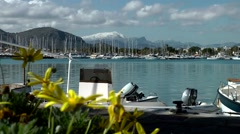 Spain Mallorca Island Port d'Alcudia 001 bay with boats and mountain scenery Stock Footage