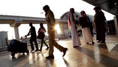 Passengers Departing and Arriving at Dubai International Airport, UAE Stock Footage