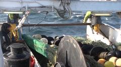Fishing boat retrieves net Stock Footage