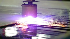 An industrial laser or plasma is cutting a steel metal sheet Stock Footage