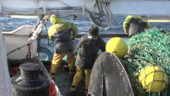 Fishing boat retrieves net 2 Stock Footage