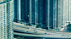 Time lapse aerial view of modern city busy highway. Hong Kong, tilt shift Stock Footage