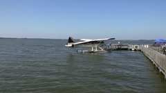 Seaplane Drifting Away From Dock Stock Footage