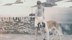 Great St Bernard, Switzerland 1950s: boy with a dog Stock Footage