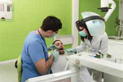 Medical Care A Patient With A Toothache Stock Photos