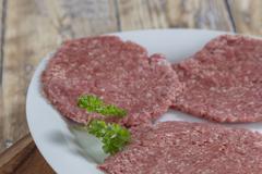 Homemade hamburger patties Stock Photos