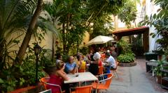 Cuba Havana Habana locals eating at Jardin del Oriente restaurant in Old Havana Stock Footage