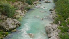 AERIAL SLOW MOTION: Turquoise rapid river running through woods Stock Footage