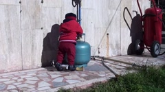 Little child plays with gas bottle - stock footage