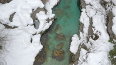 AERIAL: Flying above narrow river gorge in winter Stock Footage