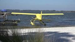 Yellow Seaplane At Dock By Dock Stock Footage