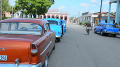 Palmira Cuba old town with classic American cars parked around main center Stock Footage