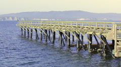 Looking over the historic Point Reyes lifeboat launching ramp at Drakes bay 2 Stock Footage