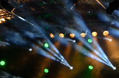 many multicolored spotlights on a stage for concert - stock photo