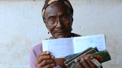 Trinidad Cuba woman with ration book for rations for food supplies in Cuba with - stock footage