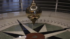 Camera follows a Foucault pendulum as it swings - stock footage