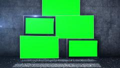 tv screens in green screen picture in front of a grunge wall - stock footage