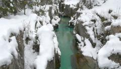 AERIAL: Turquoise river running through narrow canyon in winter Stock Footage